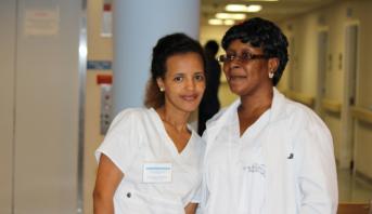 nurses facing forward and smiling