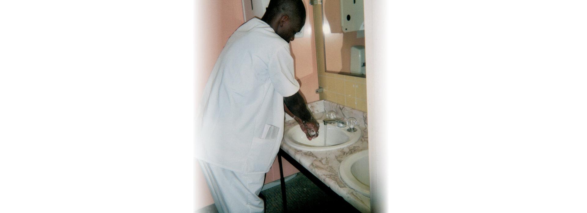 male nurse washing hands