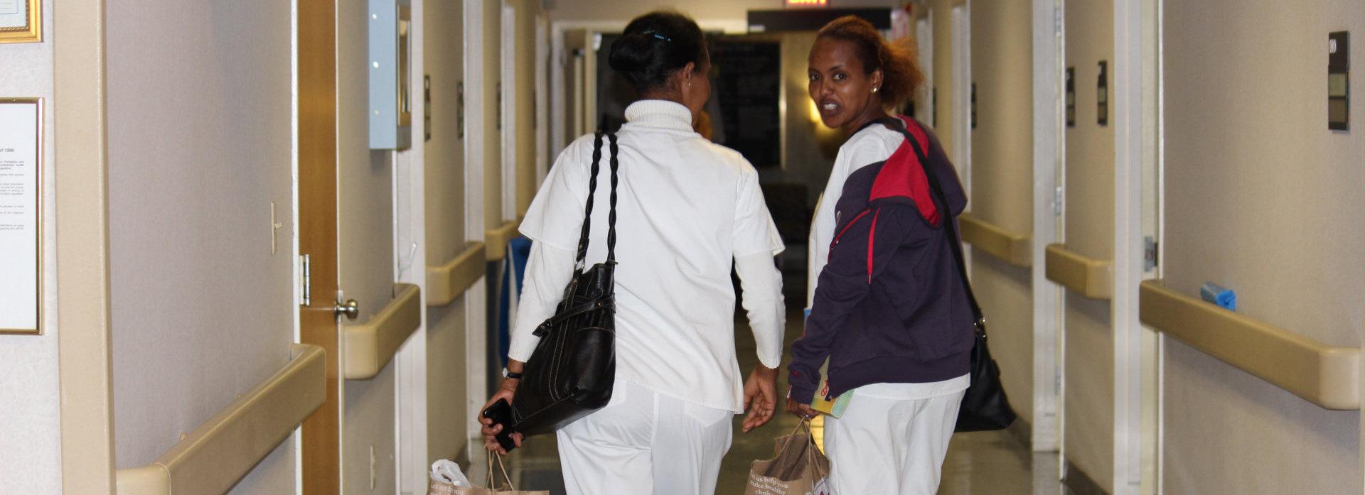 two nurse walking down the hallway