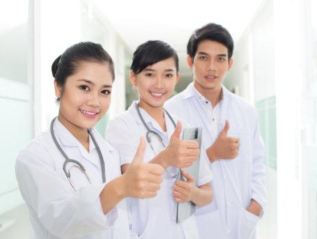 nurses thumbs up smiling
